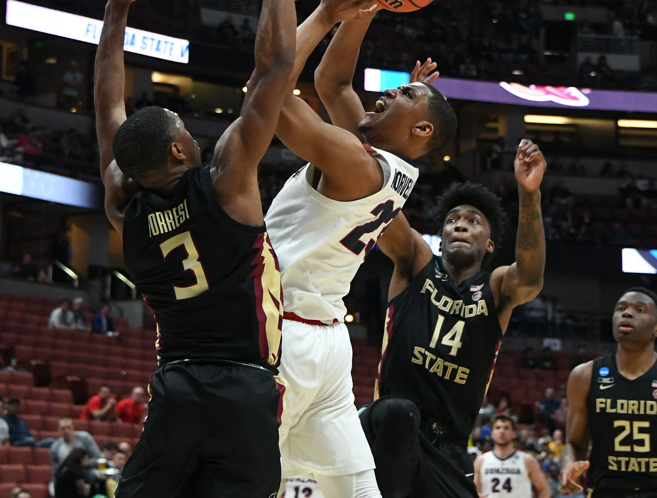 March 28, 2019; Anaheim, CA, USA; Gonzaga Bulldogs guard Zach Norvell Jr. (23) moves to the basket against Florida State Seminoles guard Trent Forrest (3) and guard Terance Mann (14) during the first half in the semifinals of the west regional of the 2019 NCAA Tournament at Honda Center. Mandatory Credit: Richard Mackson-USA TODAY Sports