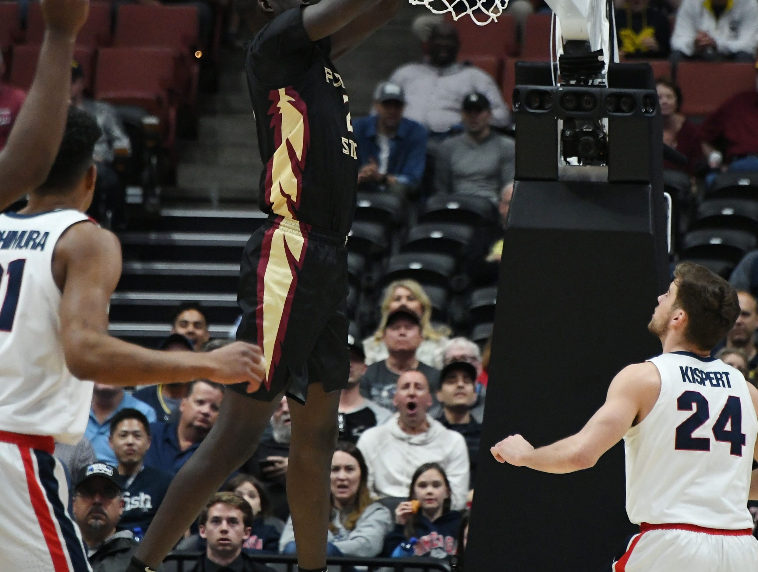 March 28, 2019; Anaheim, CA, USA; Florida State Seminoles center Christ Koumadje (21) scores a basket against Gonzaga Bulldogs during the first half in the semifinals of the west regional of the 2019 NCAA Tournament at Honda Center. Mandatory Credit: Richard Mackson-USA TODAY Sports