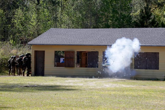 Leon County Special Weapons and Tactics (SWAT) team members set off an explosive on a door in a hostage situation during a demonstration by the SWAT team at the Florida Public Safety Institute Thursday, March 28, 2019.