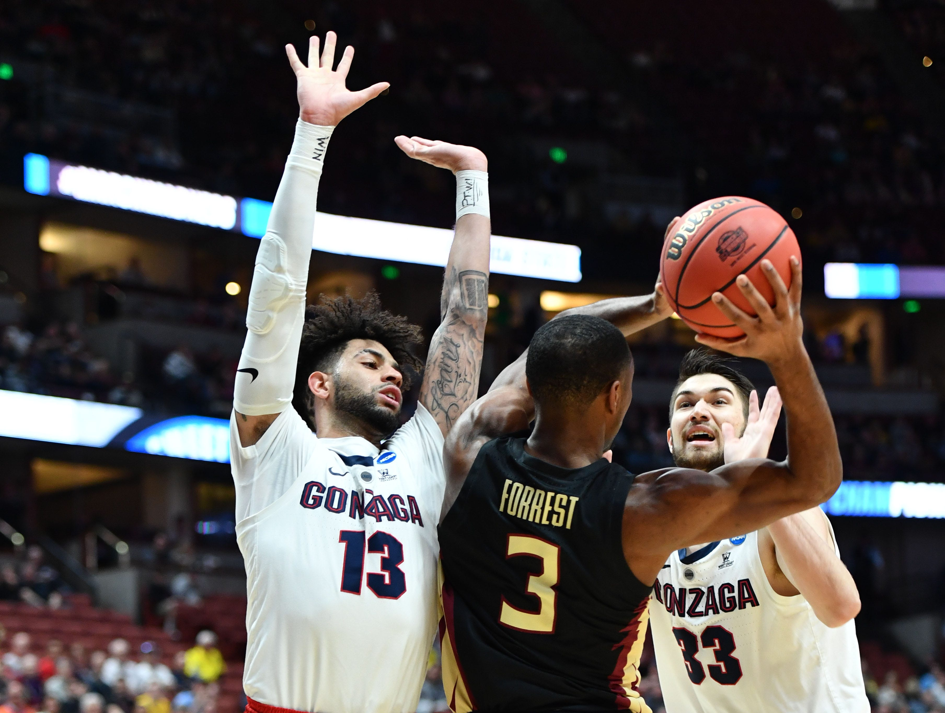 March 28, 2019; Anaheim, CA, USA; Gonzaga Bulldogs guard Josh Perkins (13) and forward Killian Tillie (33) defend against Florida State Seminoles guard Trent Forrest (3) during the first half in the semifinals of the west regional of the 2019 NCAA Tournament at Honda Center. Mandatory Credit: Robert Hanashiro-USA TODAY Sports