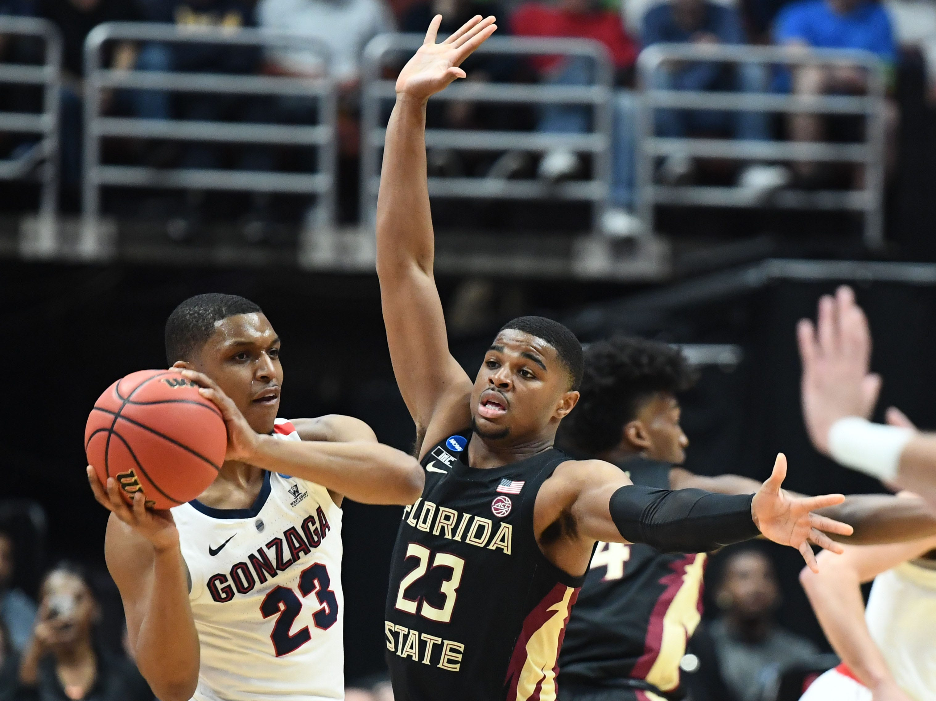 March 28, 2019; Anaheim, CA, USA; Gonzaga Bulldogs guard Zach Norvell Jr. (23) passes against Florida State Seminoles guard M.J. Walker (23) during the first half in the semifinals of the west regional of the 2019 NCAA Tournament at Honda Center. Mandatory Credit: Robert Hanashiro-USA TODAY Sports