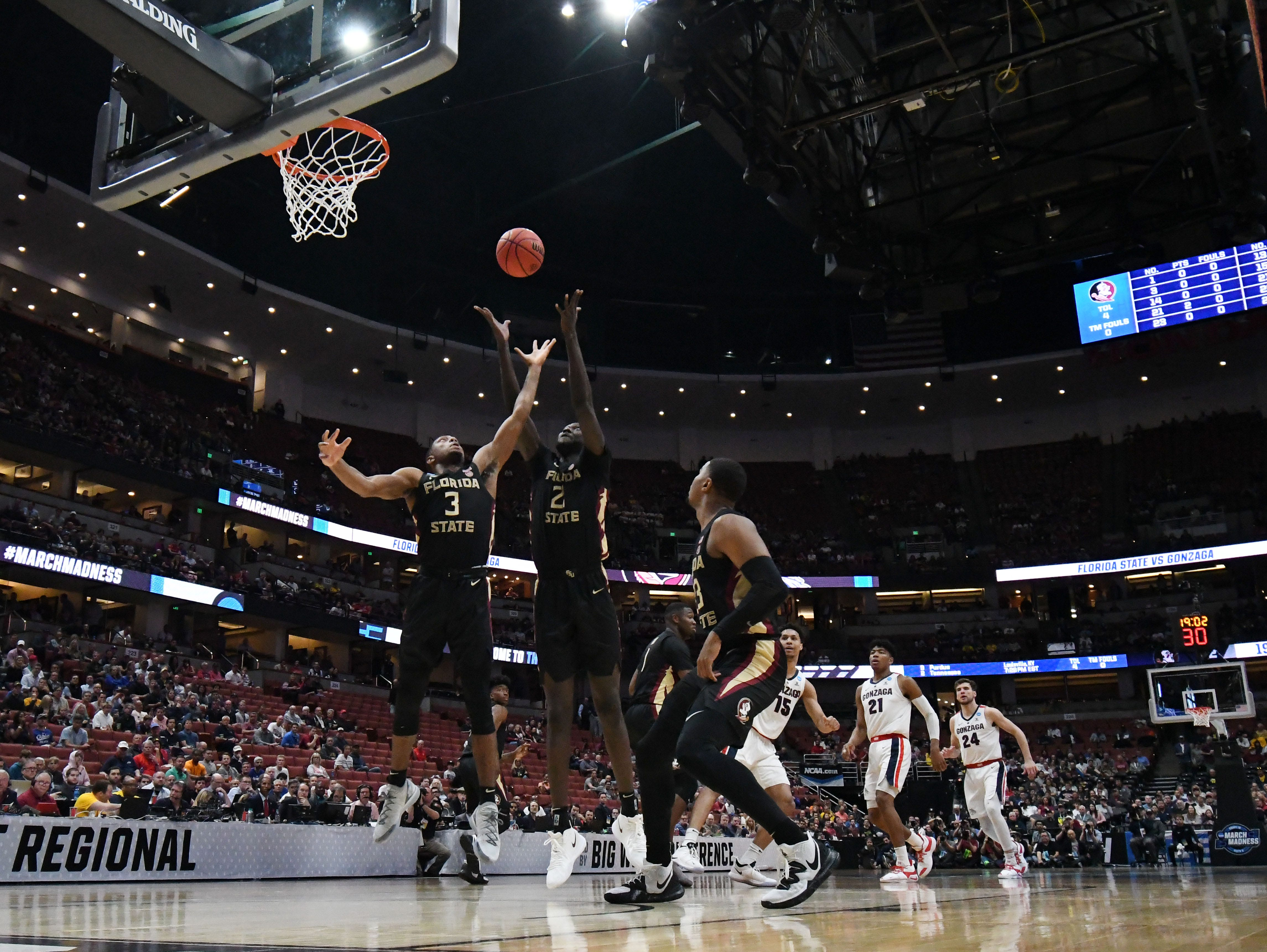 March 28, 2019; Anaheim, CA, USA; Florida State Seminoles guard Trent Forrest (3) and center Christ Koumadje (21) plays for the rebound against Gonzaga Bulldogs during the first half in the semifinals of the west regional of the 2019 NCAA Tournament at Honda Center. Mandatory Credit: Richard Mackson-USA TODAY Sports