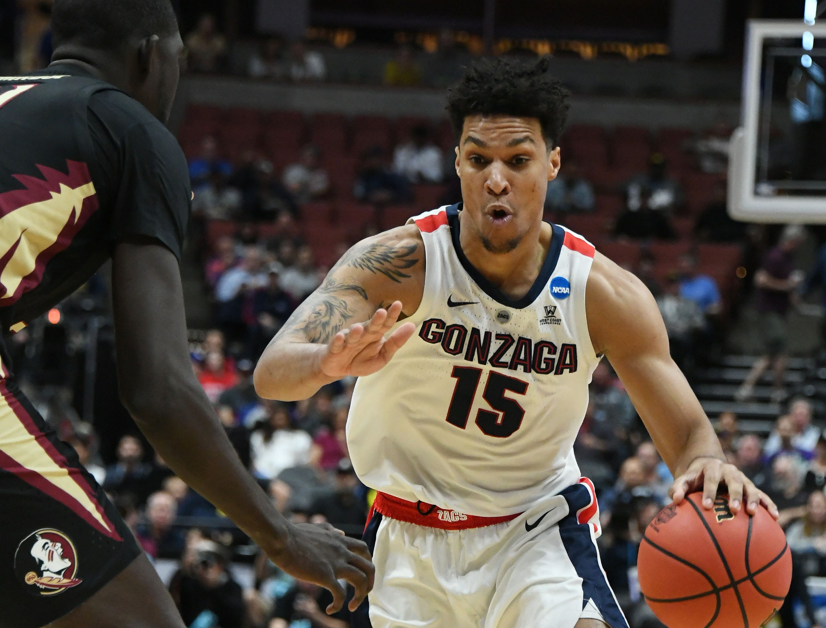 March 28, 2019; Anaheim, CA, USA; Gonzaga Bulldogs forward Brandon Clarke (15) moves to the basket against Florida State Seminoles center Christ Koumadje (21) during the first half in the semifinals of the west regional of the 2019 NCAA Tournament at Honda Center. Mandatory Credit: Richard Mackson-USA TODAY Sports