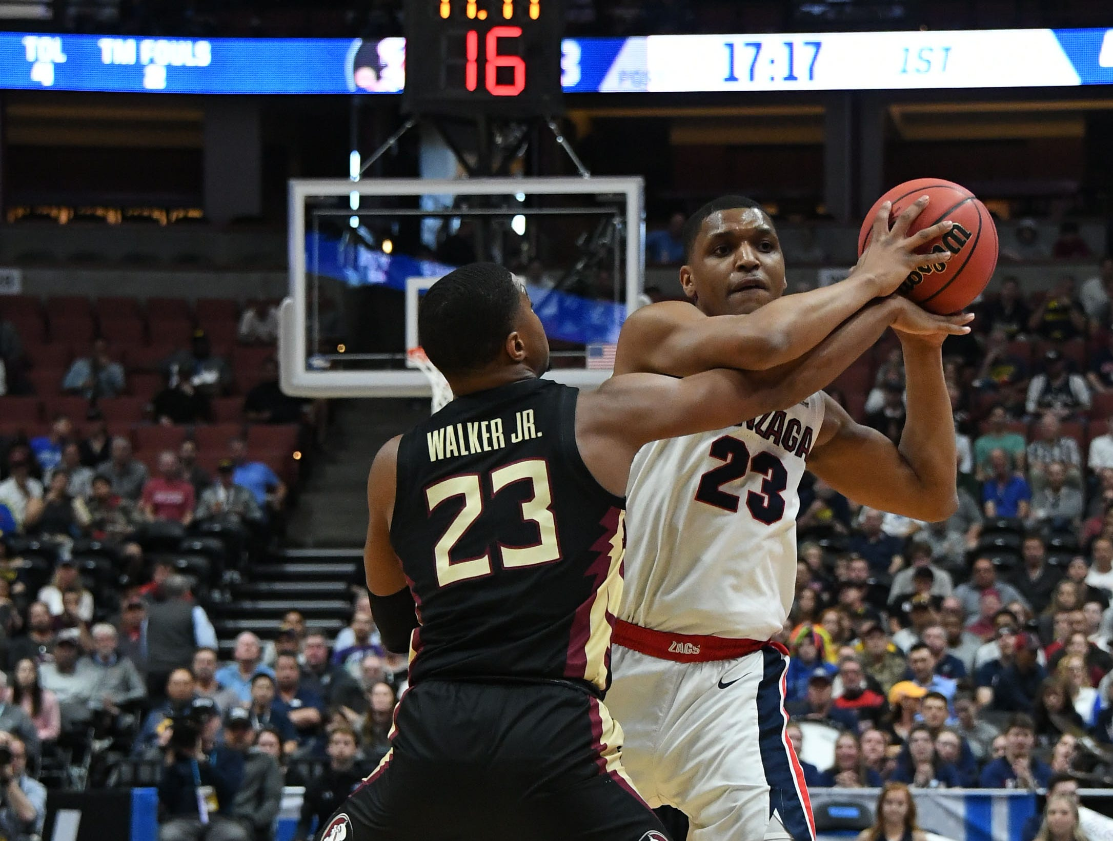 March 28, 2019; Anaheim, CA, USA; Gonzaga Bulldogs guard Zach Norvell Jr. (23) moves the ball against Florida State Seminoles guard M.J. Walker (23) during the first half in the semifinals of the west regional of the 2019 NCAA Tournament at Honda Center. Mandatory Credit: Richard Mackson-USA TODAY Sports