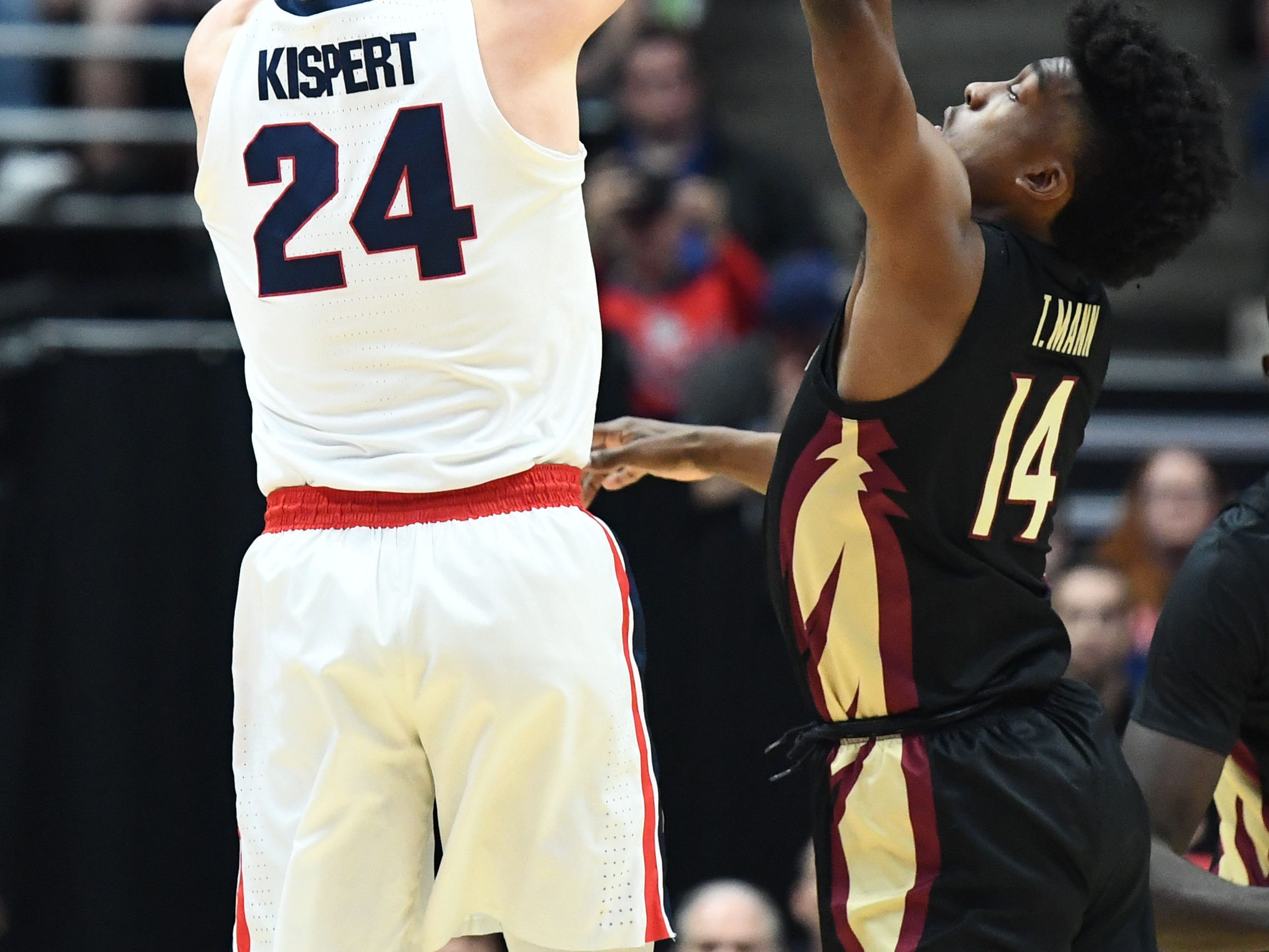 March 28, 2019; Anaheim, CA, USA; Gonzaga Bulldogs forward Corey Kispert (24) shoots against Florida State Seminoles guard Terance Mann (14) during the first half in the semifinals of the west regional of the 2019 NCAA Tournament at Honda Center. Mandatory Credit: Robert Hanashiro-USA TODAY Sports