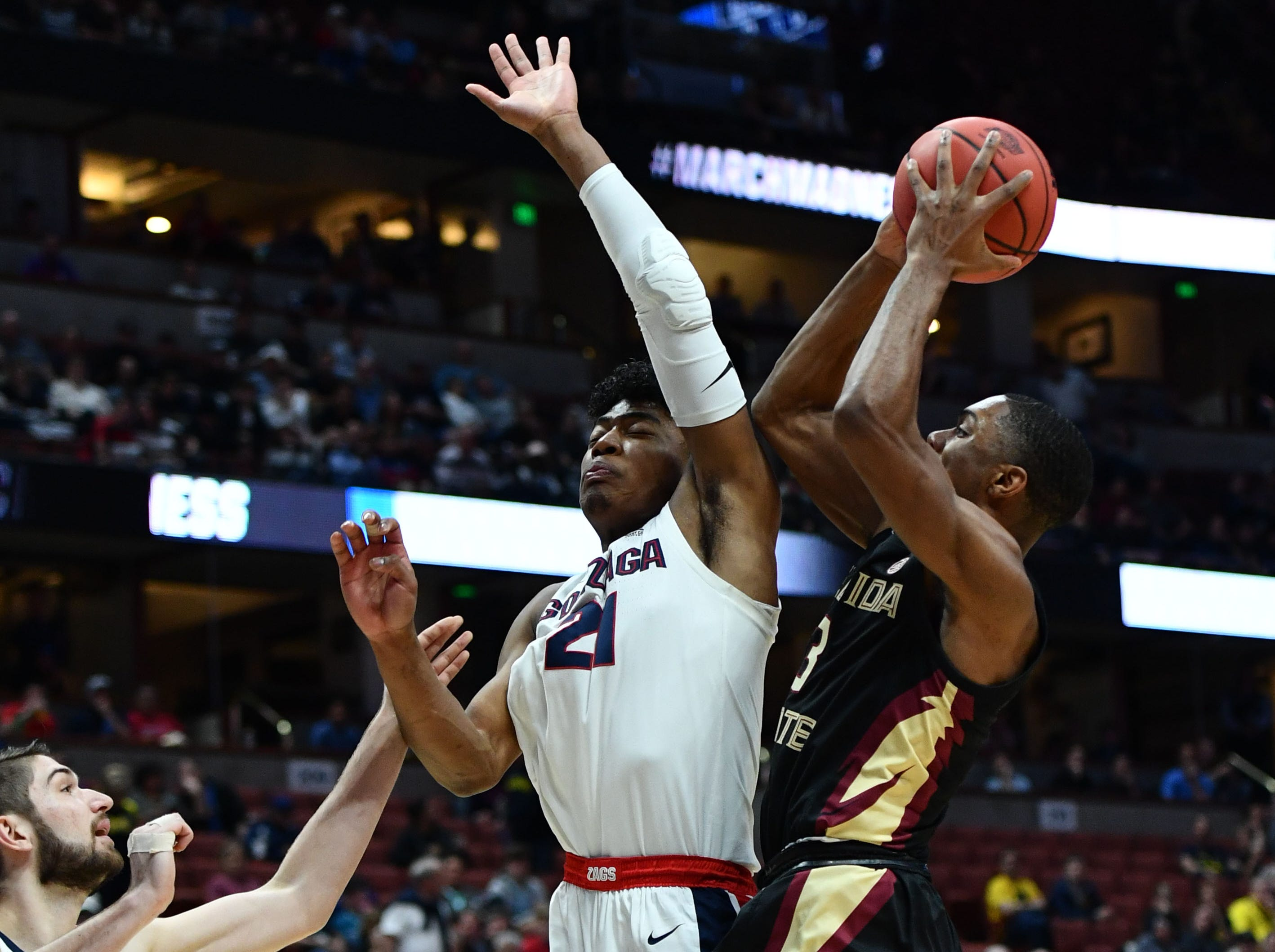 March 28, 2019; Anaheim, CA, USA; Florida State Seminoles guard Trent Forrest (3) shoots against Gonzaga Bulldogs forward Rui Hachimura (21) during the first half in the semifinals of the west regional of the 2019 NCAA Tournament at Honda Center. Mandatory Credit: Robert Hanashiro-USA TODAY Sports