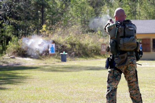 "Sgt. Morgan Wysocki shoots a bullet that he calls his ""magic bullet"" at a target during a demonstration by the Leon County Special Weapons and Tactics team at the Florida Public Safety Institute Thursday, March 28, 2019."