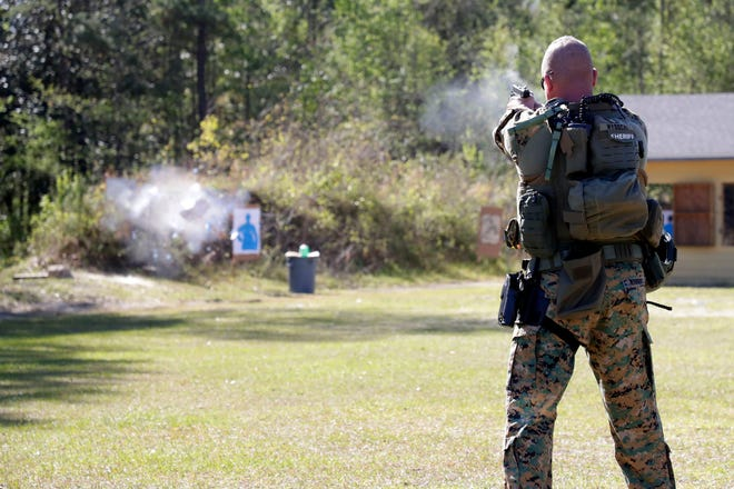 """Sgt. Morgan Wysocki shoots a bullet that he calls his """"magic bullet"""" at a target during a demonstration by the Leon County Special Weapons and Tactics team at the Florida Public Safety Institute Thursday, March 28, 2019."""