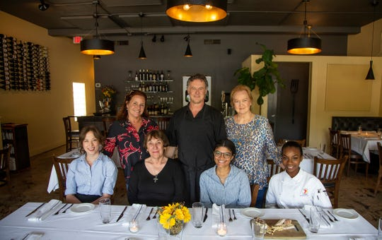 """William Lawson and his wife Holly, with his mother, Regena at right. Seated, from left: Natalie Carballo, Rebecca """"Mimi"""" Johnson, Olivia Brevatt and Erin Wallace at Mimi's Table restaurant at 1311 Miccosukee Road in Tallahassee."""