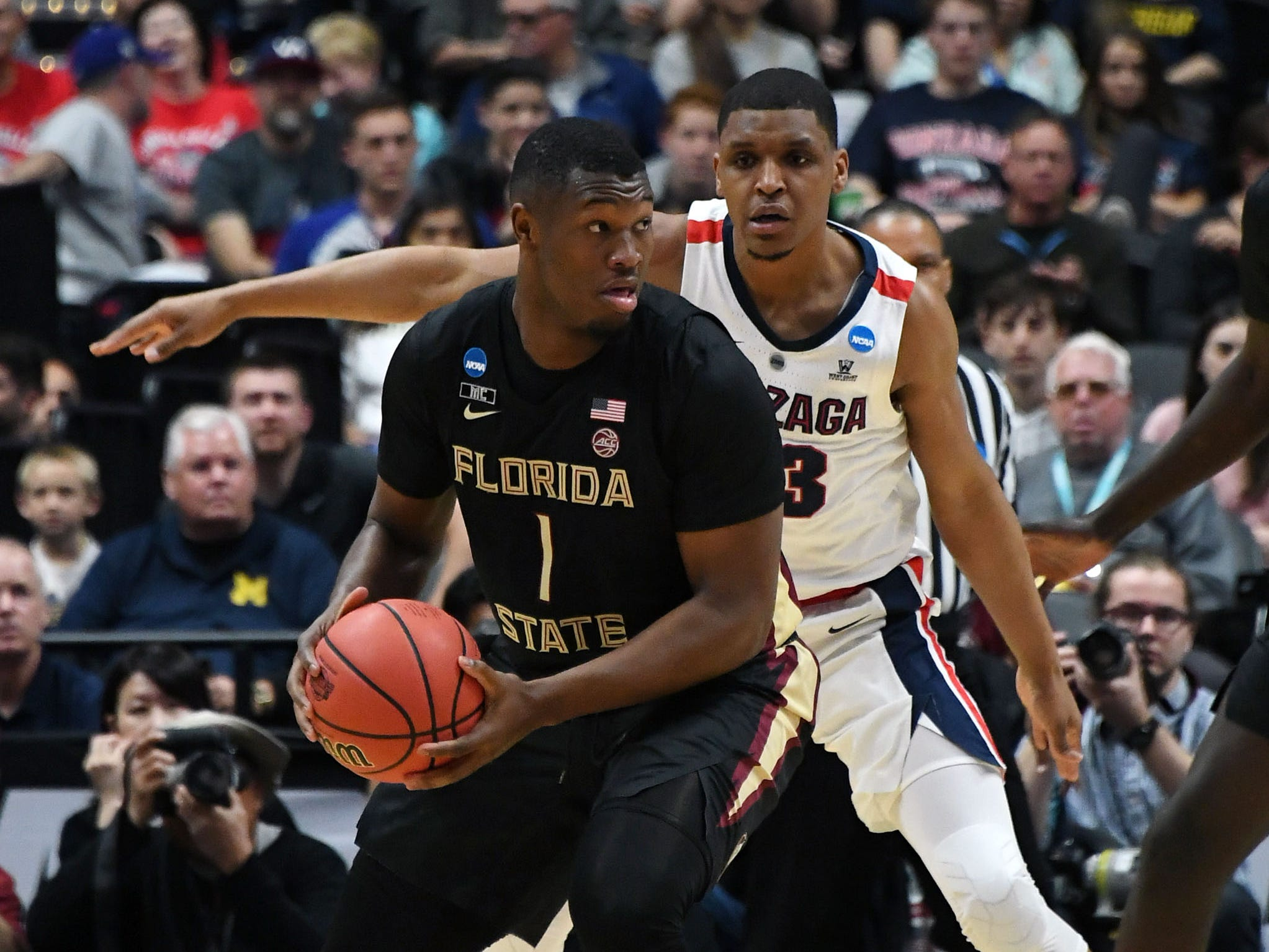 March 28, 2019; Anaheim, CA, USA; Florida State Seminoles forward Raiquan Gray (1) moves the ball against Gonzaga Bulldogs guard Zach Norvell Jr. (23)during the first half in the semifinals of the west regional of the 2019 NCAA Tournament at Honda Center. Mandatory Credit: Richard Mackson-USA TODAY Sports