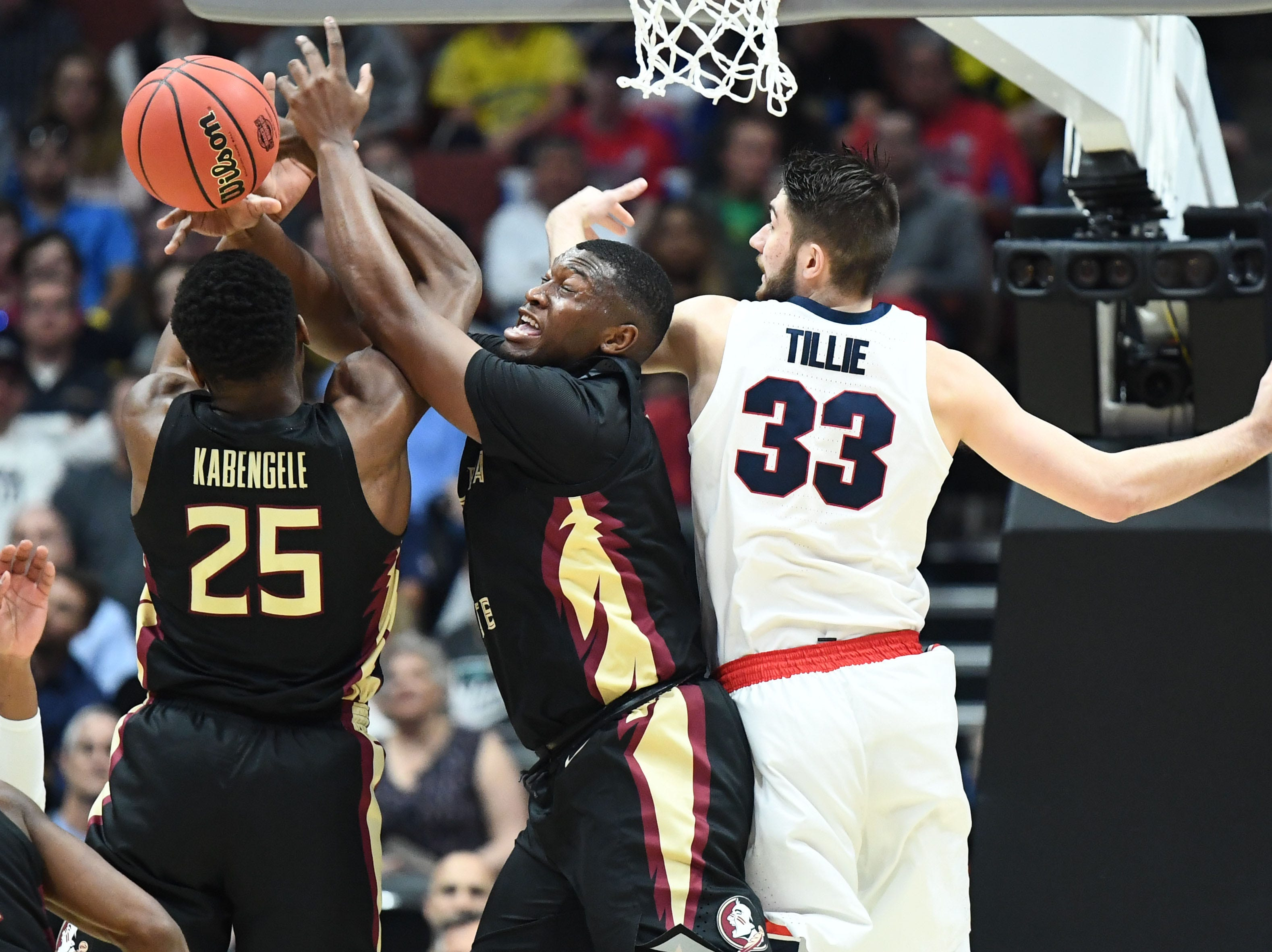 March 28, 2019; Anaheim, CA, USA; Florida State Seminoles forward Mfiondu Kabengele (25) plays for the rebound against Gonzaga Bulldogs forward Killian Tillie (33) during the first half in the semifinals of the west regional of the 2019 NCAA Tournament at Honda Center. Mandatory Credit: Robert Hanashiro-USA TODAY Sports