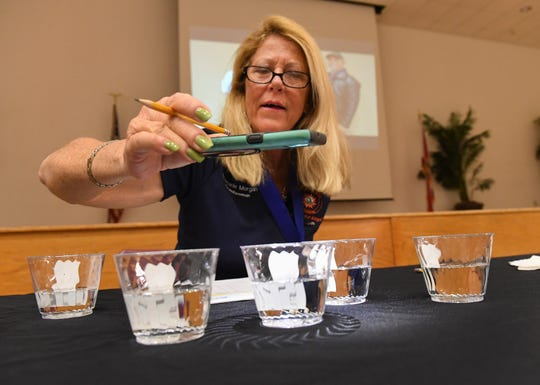 """Port St. Lucie Councilwoman Stephanie Morgan checks the clarity and color of several water samples as one of three judges during the Florida Section American Water Works Association Region VIII 2019 Best Tasting Drinking Water Contest on Thursday, March 28, 2019, at the Port St. Lucie Community Center. """"I was pretty amazed that water does have odor, many of them did, and how different they did taste,"""" Morgan said. Water samples from eight participating utilities, the Fort Pierce Utilities Authority, Indian River County, Martin County, Port St. Lucie, St. Lucie West, St. Lucie County, Seminole Tribe of Florida, and Vero Beach, were scrutinized for clarity, color, odor, and taste by judges Stefanie Myers, health promotion coordinator for the Department of Health in St Lucie County, Gil Smart, opinion columnist for TCPalm, and Councilwoman Morgan. The Seminole Indian Tribe of Florida took the top spot for the third year in a row, and Fort Pierce Utilities Authority was named the first runner-up."""