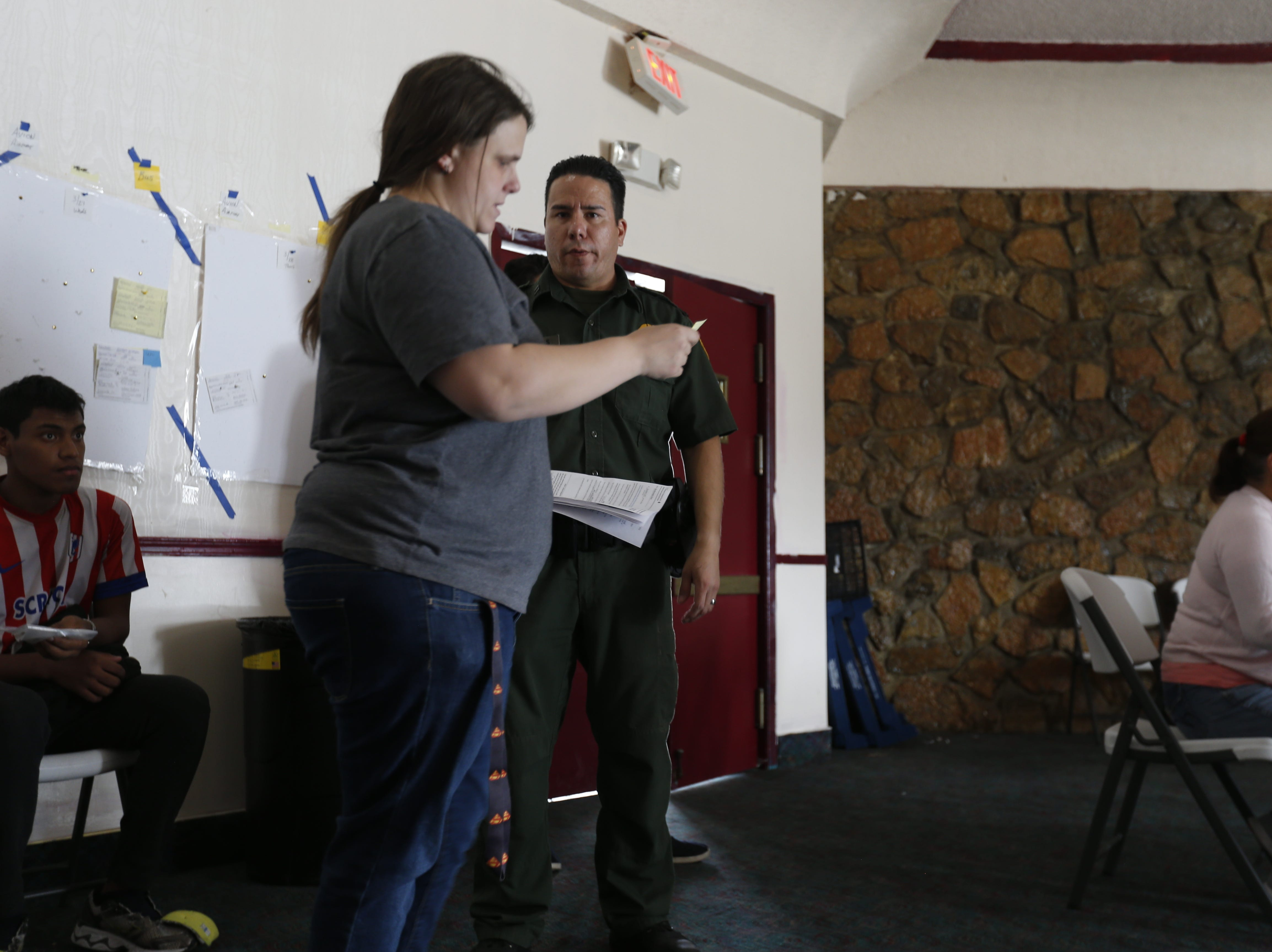 A U.S. Border Patrol agent visits with Annunciation House volunteer Mary Bull after bringing a migrant with special needs.
