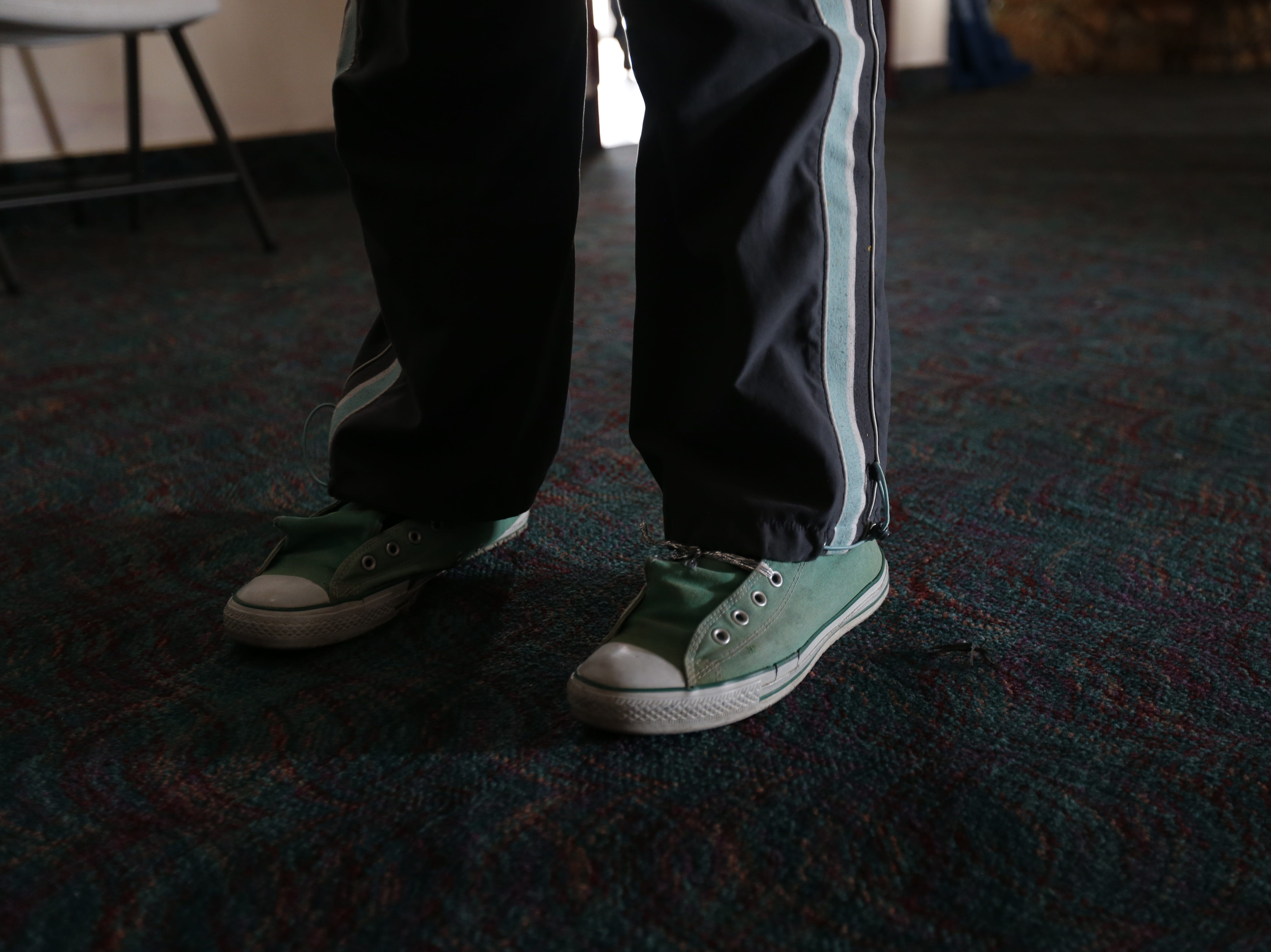 Migrants left at a west El Paso hotel on Wednesday used small pieces of mylar thermal blankets to tie their shoes and put their hair into a ponytail.