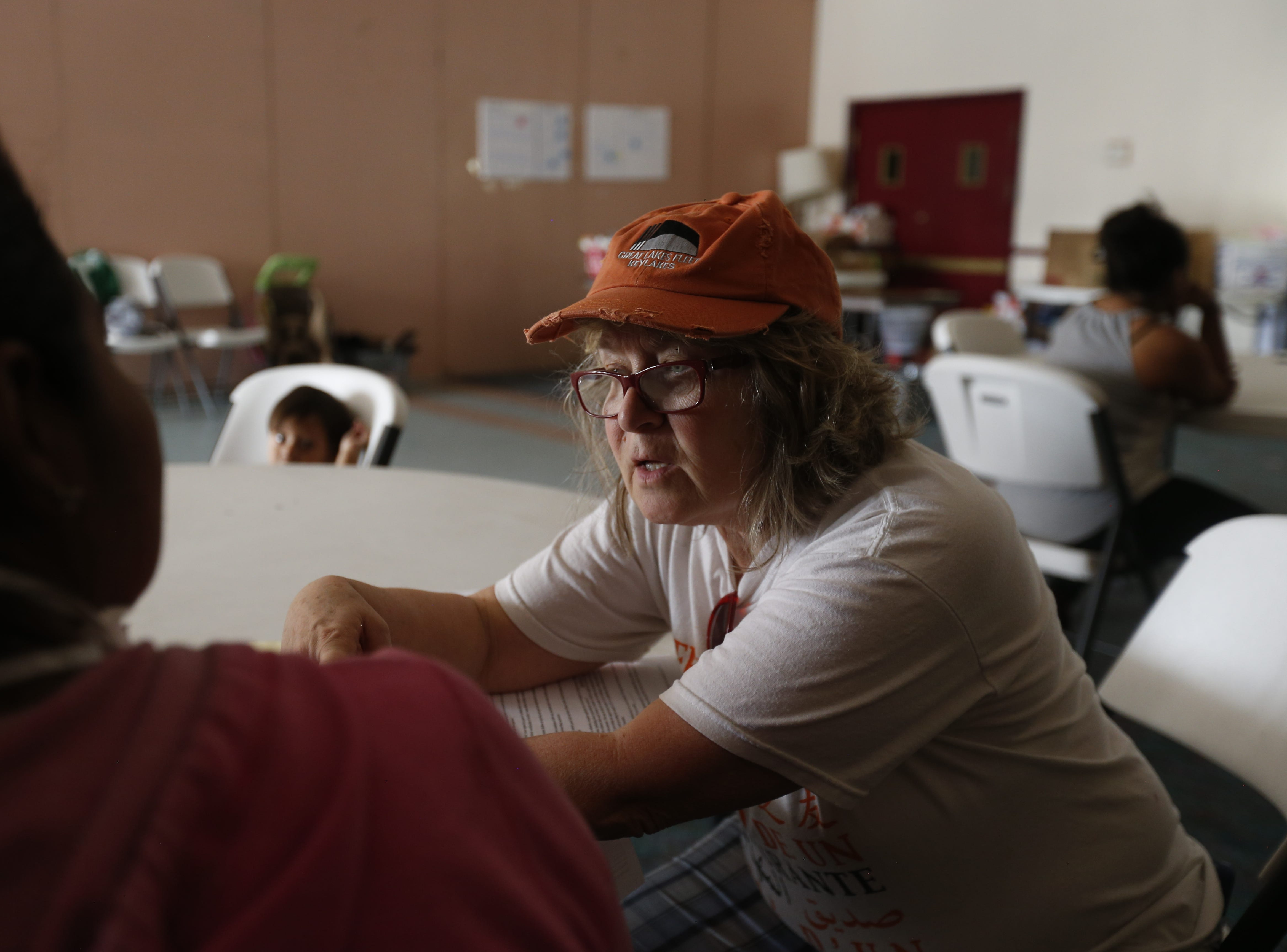 Ande McCarthy helps a migrant woman from Guatemala get in contact with her family in the United States.