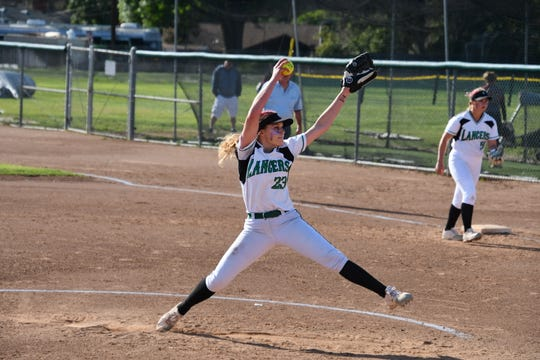 Thousand Oaks senior Shannon Haddad delivers a pitch against Oaks Christian on Tuesday in Thousand Oaks. Oaks Christian won, 3-2, in eight innings.