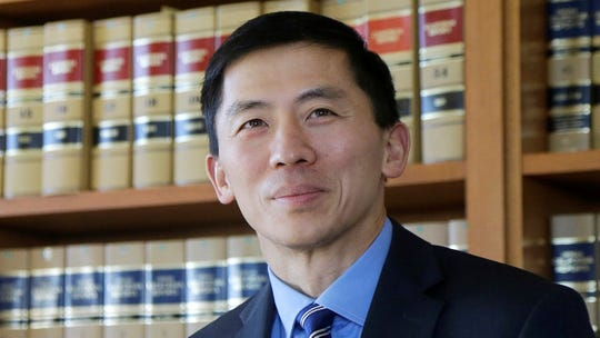 In this Jan. 13, 2017, file photo California Supreme Court Associate Justice Goodwin Liu pauses in his office in San Francisco. The California Supreme Court justice says the death penalty system in the most populous state is dysfunctional, expensive and doesn't deliver justice in a timely way.