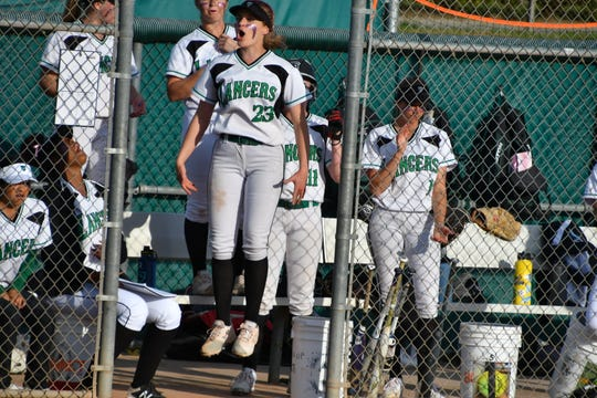 Thousand Oaks senior Shannon Haddad celebrates the Lancers tying the game against Oaks Christian in the seventh inning on Tuesday. The Lions won, 3-2, in eight innings.
