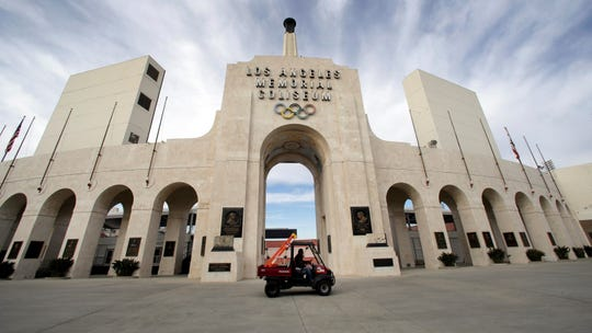 This Jan. 13, 2016 file photo shows the peristyle of the Los Angeles Memorial Coliseum in Los Angeles. The University of Southern California's sale of naming rights for Los Angeles Memorial Coliseum is being criticized as dishonoring the historic stadium's dedication as a memorial to soldiers who fought and died in World War I.
