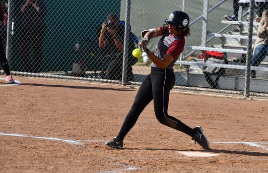 Shortstop Maya Brady slugs a game-winning home run in the eighth inning of Oaks Christian's 3-2 win over host Thousand Oaks on Tuesday.