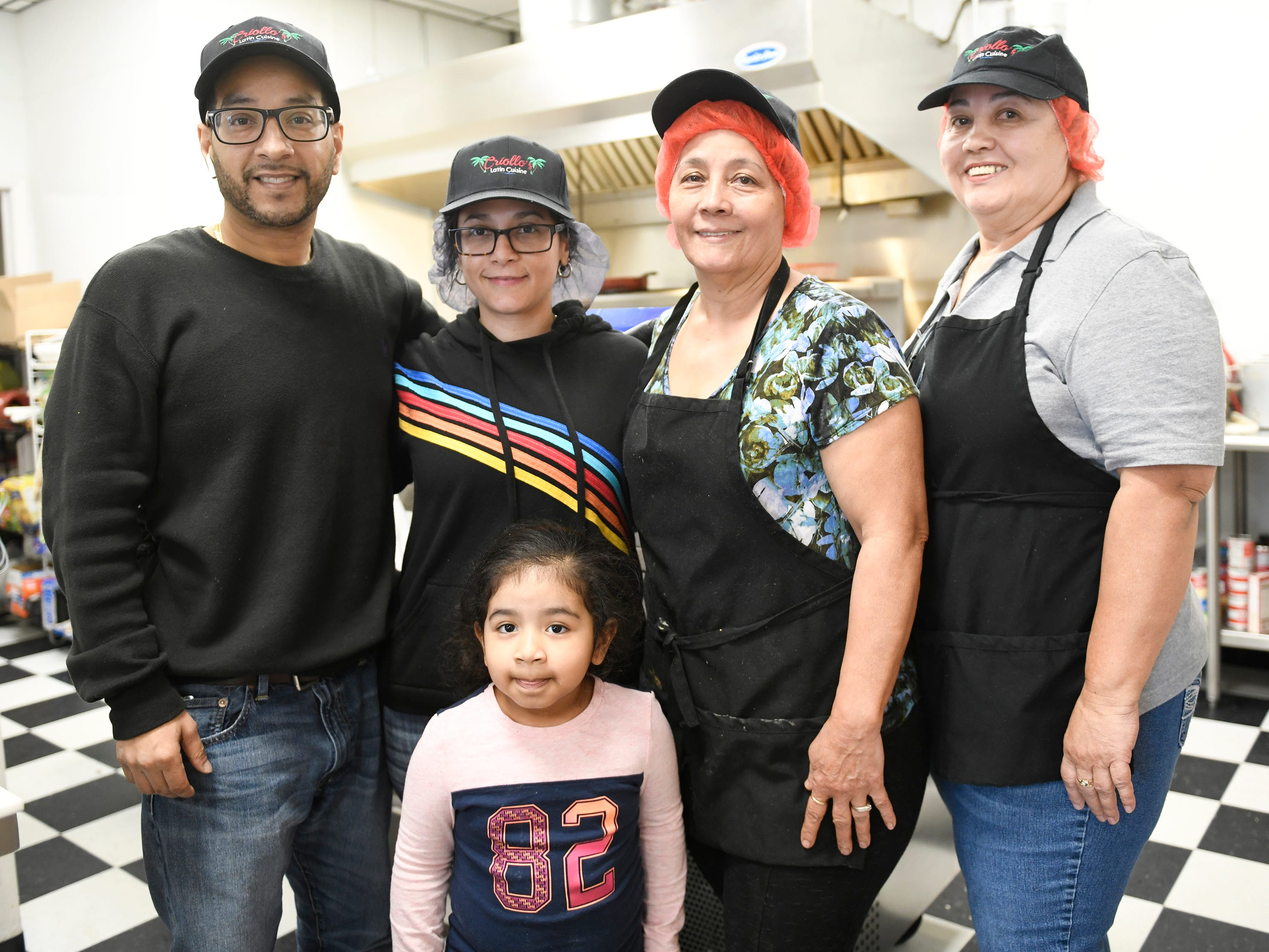 From left to right, Criollo's Latin Cuisine owners Scott and Elsie Guzman, Emy Flores, Kathy Flores and the Guzman's daughter Eliar pose for a photo inside the Millville restaurant.