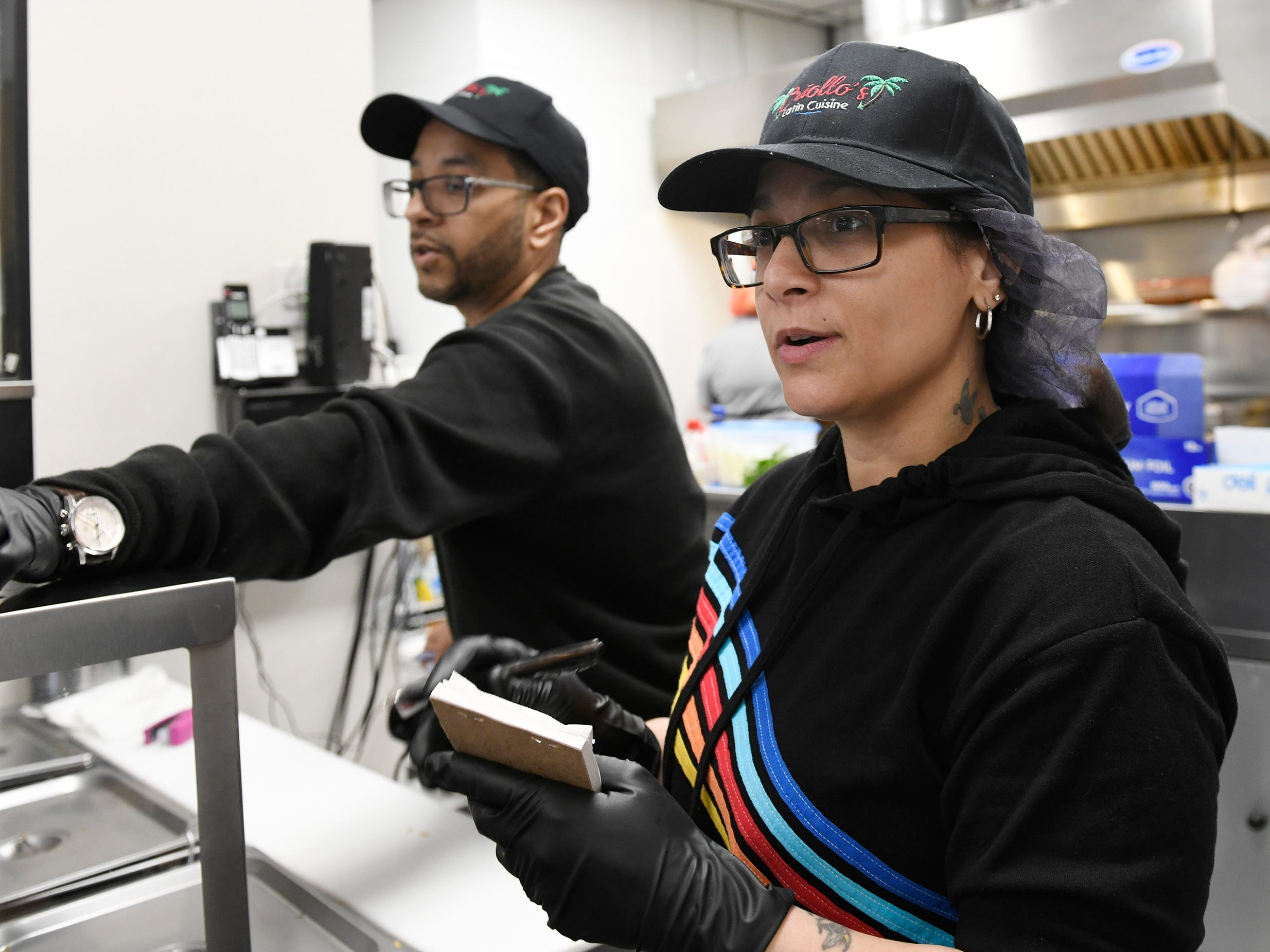 Owners Scott and Elsie Guzman get ready for the lunch rush at Criollo's Latin Cuisine in Millville on Wednesday, March 27, 2019. The restaurant is located inside the EZ-Mart on West Main Street.