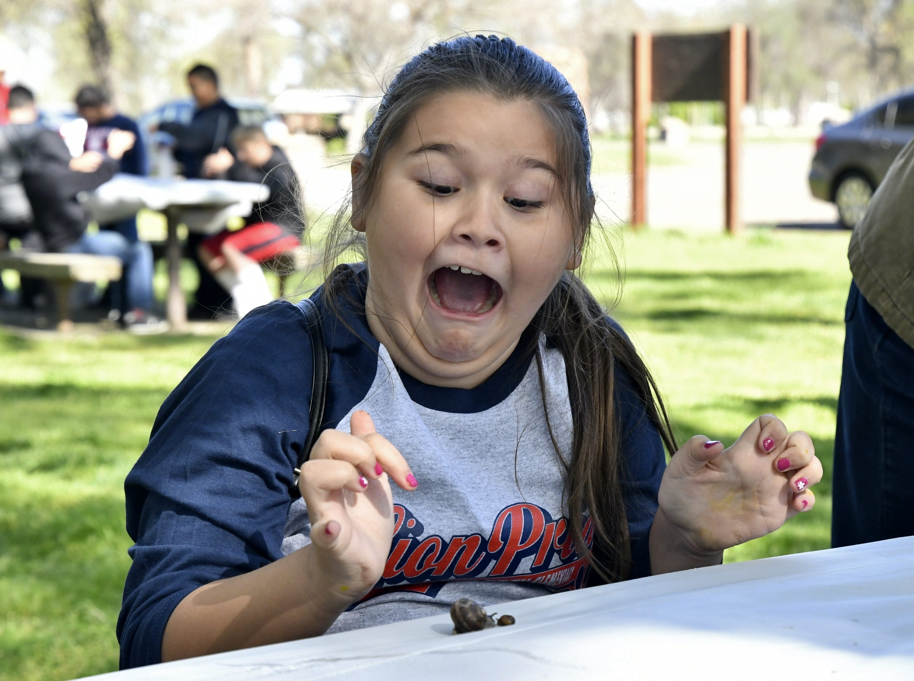 Liberty Elementary fourth grader Chloe Porter, 10, reacts to seeing a snail at TCOE's Arbor Day event at Mooney Grove Park on Thursday, March 28, 2019.