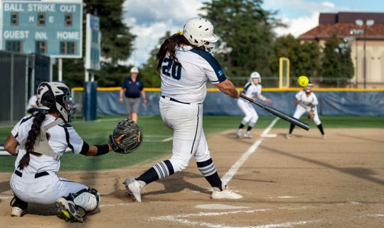 Redwood's Abigail Hillan hits a home run against Golden West in a West Yosemite League high school softball game on Wednesday, March 27, 2019.