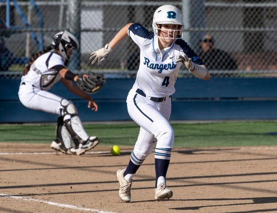 Redwood's Hailey Smithson runs to first on a bunt against Golden West in a West Yosemite League high school softball game on Wednesday, March 27, 2019.