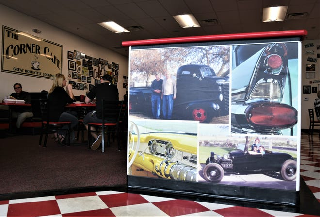Photos of cars that The Corner Cafe-founder Byron Taylor restored and raced line the walls of his diner. Taylor passed away on Saturday but the diner will continue to honor his memory.