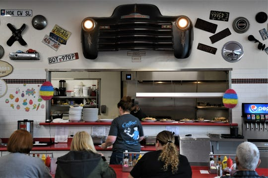 The front end of a '47 pickup truck rests above the counter at The Corner Cafe.