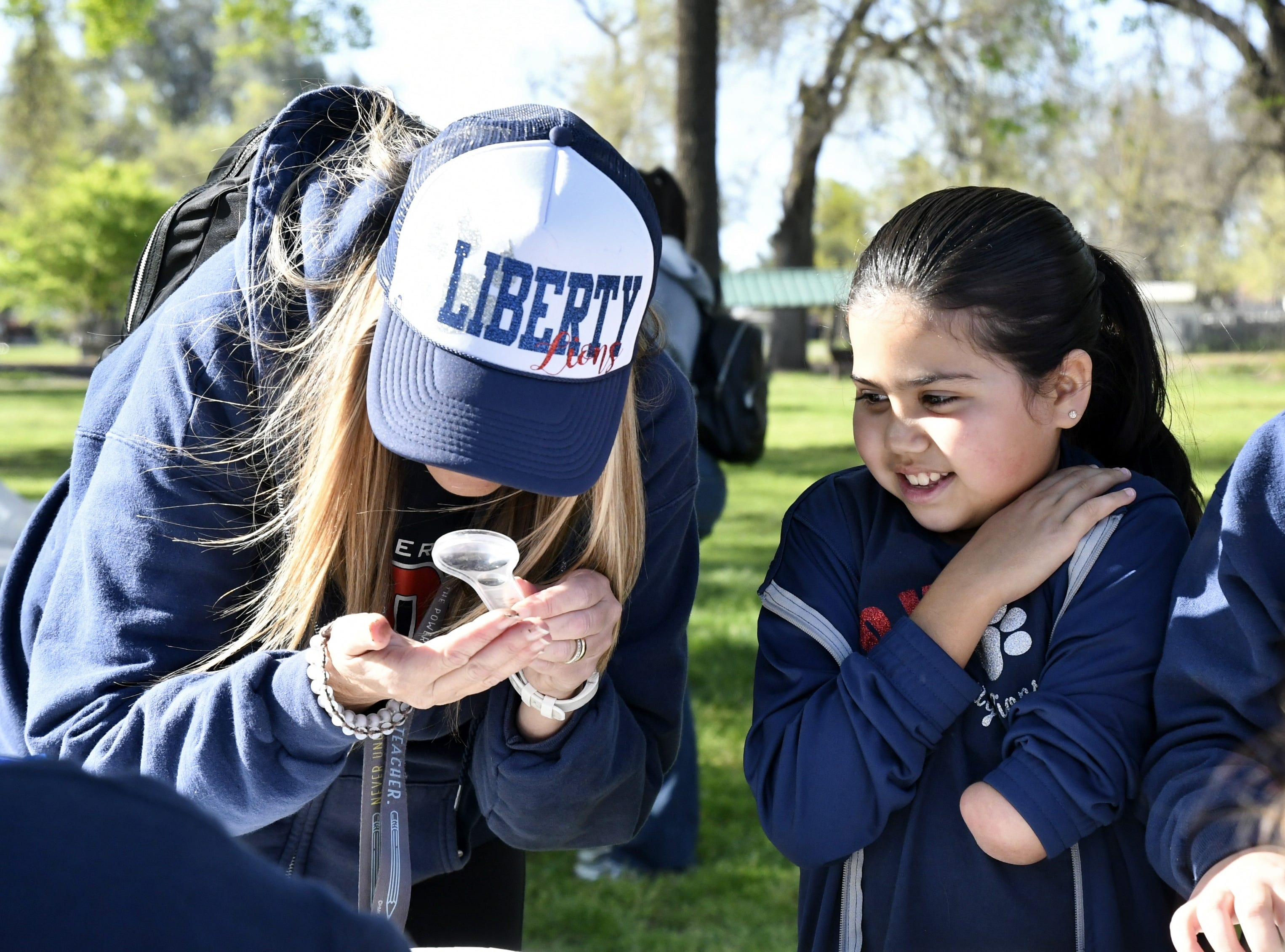 Nearly 100 students celebrate Arbor Day at Mooney Grove Park on Thursday, March 28, 2019.