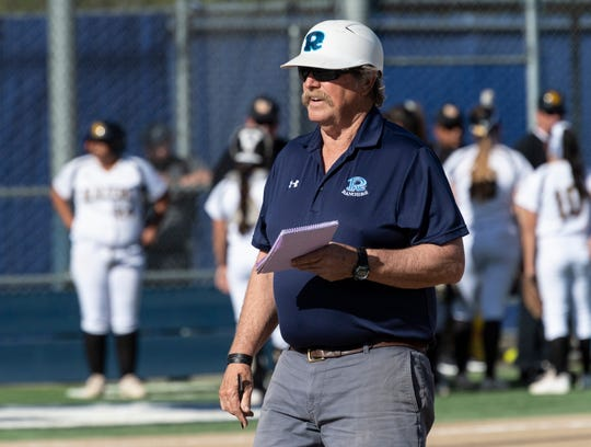 Redwood coach Bob Rooney against Golden West in a West Yosemite League high school softball game on Wednesday, March 27, 2019. This is Rooney's 25th season with the Rangers.