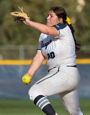 Redwood's Abigail Hillan pitches against Golden West in a West Yosemite League high school softball game on Wednesday, March 27, 2019.