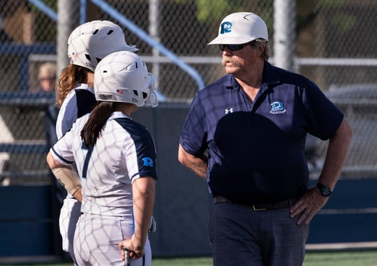Redwood coach Bob Rooney, right, against Golden West in a West Yosemite League high school softball game on Wednesday, March 27, 2019. This is Rooney's 25th season with the Rangers.