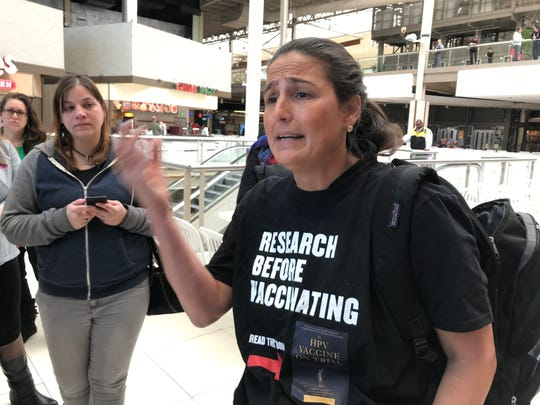 Anti-vaccination protester Stephanie Mahairas makes her case at the Palisades Center Mall in West Nyack, Thursday, March 28, 2019.