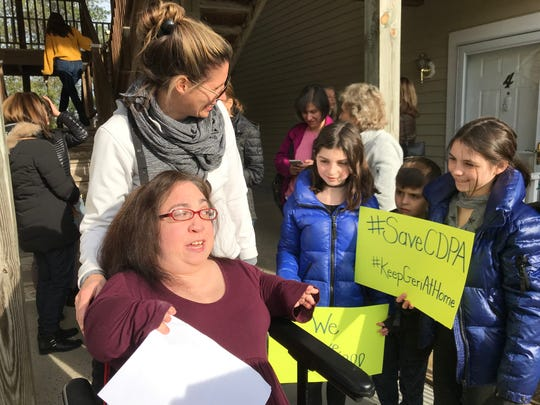 Geri Mariano talks with Beth Tambini and three of her children, Madelyn, Jack and Emily, outside Mariano's Armonk condo on March 27.