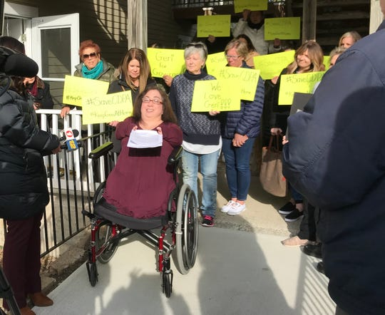 Geri Mariano holds a mini-protest outside her Armonk condo on March 27, calling out Gov. Andrew Cuomo for proposed changes to the Consumer Directed Personal Assistance Program.