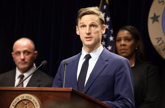 Dr. Joshua Lee MD, Associate Professor of Population Health and Medicine/General Internal Medicine and Clinical Innovation at the NYU School of Medicine and Director of the NYU Fellowship in Addiction Medicine, speaks at a press conference with Attorney General Letitia James March 28, 2019 in New York City. The attorney general is suing opioid distributors and manufacturers and the Sackler family.