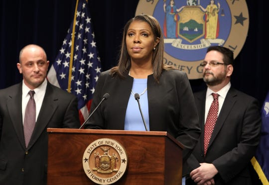 Attorney General Letitia James announces that she filed the nation's most comprehensive suit against opioid distributors and manufacturers and the Sackler family March 28, 2019 in New York City.  Recovering opioid addict Justin Sangeorge, left, and Gary Butchen, executive director of Bridge Back to Life Center join her.