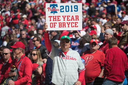 A Phillies fan holds up a '2019 The Year Of Bryce' sign Thursday at Citizens Bank Park.