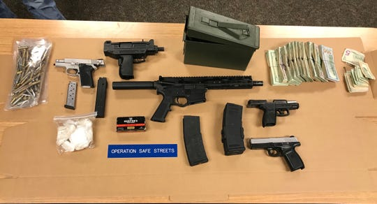 Wilmington police said guns, drugs, cash and body armor were seized during searches of a home in Wilmington and a home and car in Newark earlier this month.