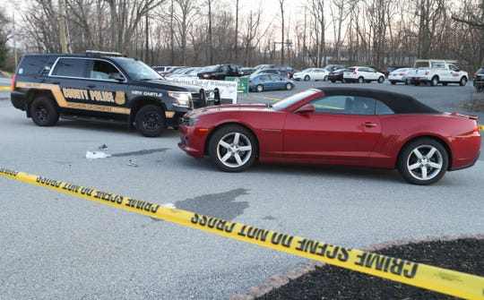 New Castle County Police investigate after three people, including two children, received minor injuries when they were struck by a car outside the Rock Manor Golf Course clubhouse on Carruthers Lane early Wednesday evening.