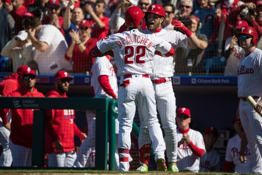 Phillies' Andrew McCutchen (22) celebrates hitting a home run with Bryce Harper (3) during the first inning Thursday against the Braves at Citizen Bank Park.