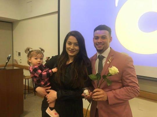 James Elliott with his girlfriend Lauren Hudson and daughter Vaeda Jade at his Phi Theta Kappa induction earlier this year.