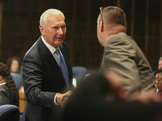 Wilmington Mayor Mike Purzycki greets city council members after delivering his budget address in the Louis L. Redding City/County Building Thursday.