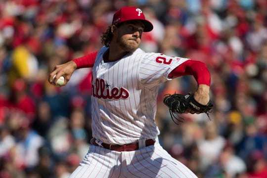 Phillies' Aaron Nola (27) pitches during the first inning against the Braves Opening Day at Citizens Bank Park.