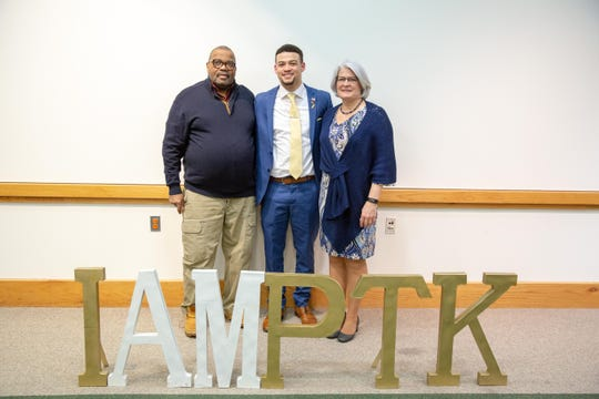 James Elliott (center) with his parents John and Robin in March at a surprise luncheon at Delaware Technical and Community College. It was there that he learned he was named as one of 20 students nationwide for the All-USA Academic Team.