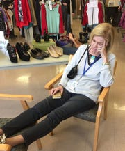 Faith Refuge steering committee member Johnelle Donnell rests for a bit during the 2018 fundraiser, which raised nearly $75,000 in two days. The 2019 resale event will be April 5 and 6 from 10 a.m. to 6 p.m. at First Presbyterian Church, 3601 Taft Blvd.