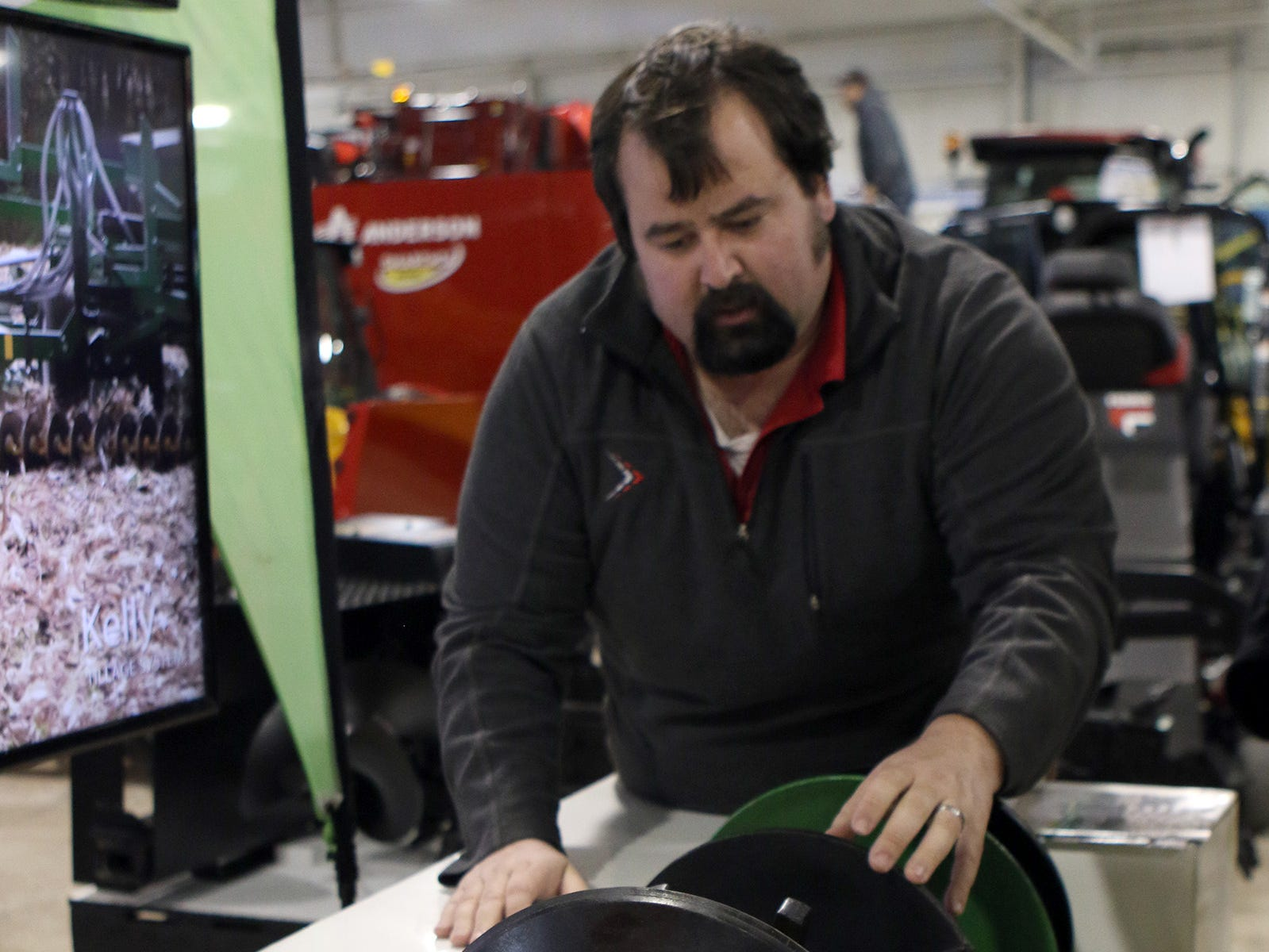 Aaron Bauer with Kelly Tillage System explains how the discs work on the tillage system during the Wisconsin Public Service Farm Show in Oshkosh on March 27.